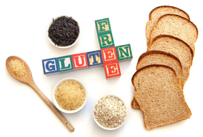 Letter blocks surrounded with gluten free products including wild rice and oats